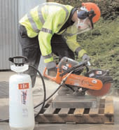 photo of a handheld power saw with dust suppression in use