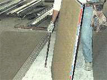 Panel carrier handle puts hand at a good height from the floor for lifting.