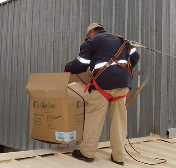 image of a worker with fall protection near a roof edge