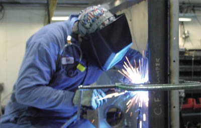 Photo of man welding