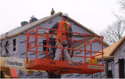 Figure 31 - Worker positioning an aerial lift.