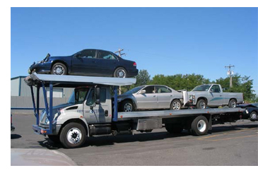 Photo of cars on transporter