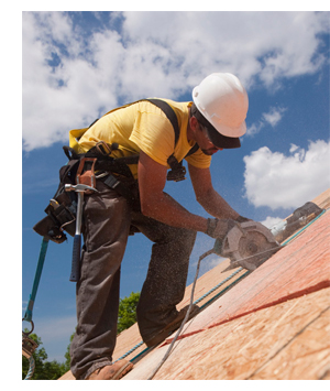 photo of roofer sawing