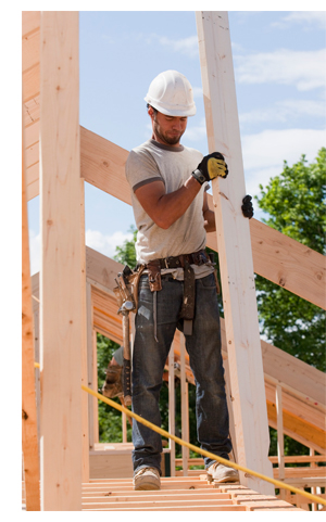 photo of worker holding lumber