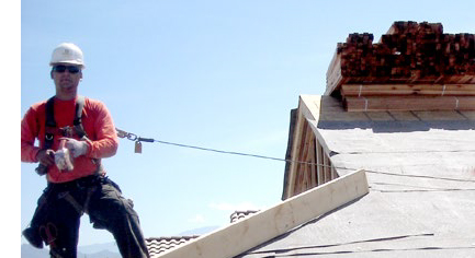 Man on a roof with safety tether