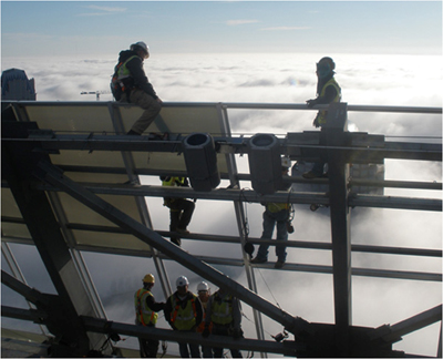 Photo: 2nd place in OSHA's 2011 photo contest, construction workers working in the clouds. Courtesy Roberto Carlos Vergara of Charlotte, North Carolina.