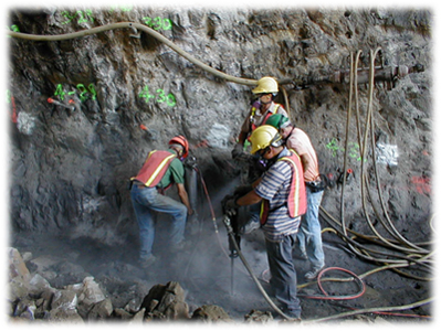 Workmen using jackhammer and enduring dust. Photo courtesy eLCOSH and Mt. Sinai School of Medicine.