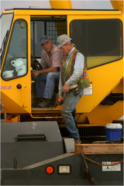 Photo of worker and manager on a machine