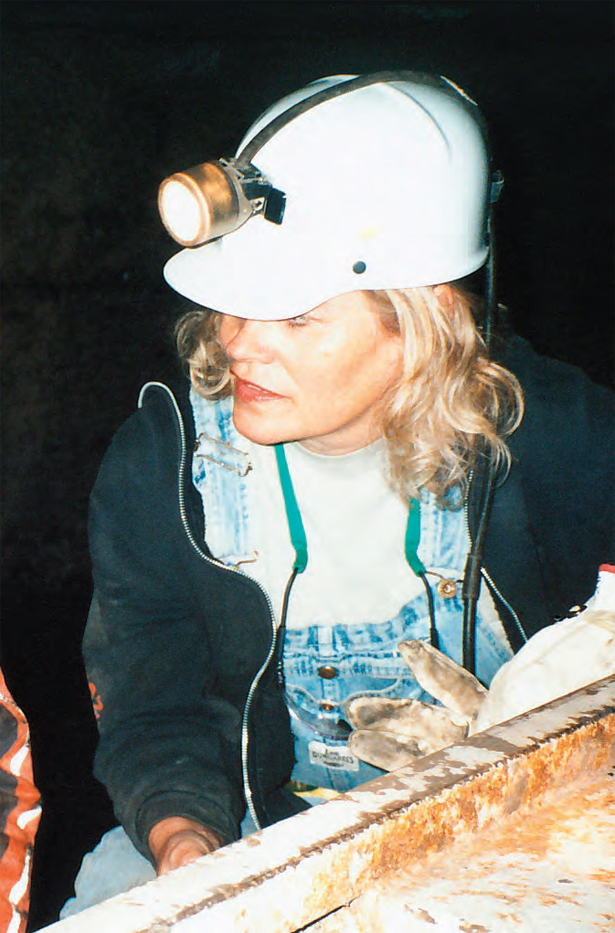 female miner talking