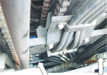 Photo of forklift mast hoses and chain drive mechanism.