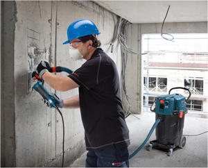 photo of a man using a tool that has a built in silica vacuum