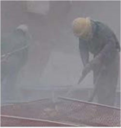 a man working in enclosed area with silica dust