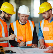 Three men making plans for construction work