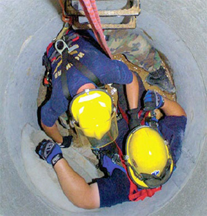 This is a picture of Emergency service workers performing a practice rescue inside a manhole photo from Oregon OSHA