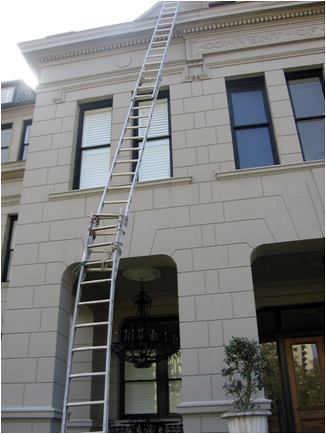 ladder tied to another ladder to make it look longer but losing integrity off the side of a building
