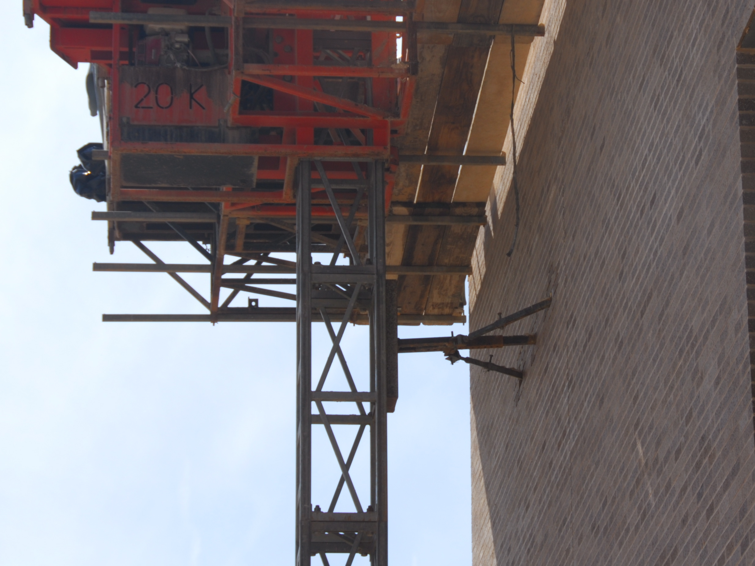 Mast Climber Scaffold tie-in to wall